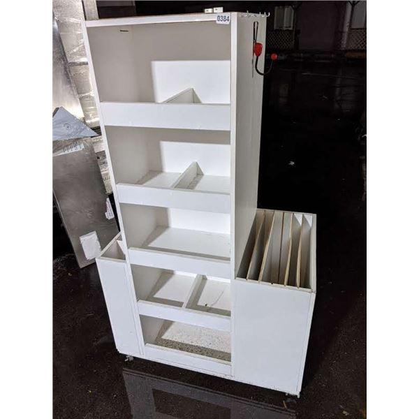 White display case on castors