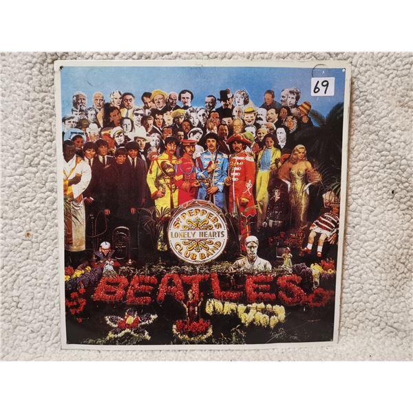 "Beatles embossed sign, 12.5"" X 12.5"""