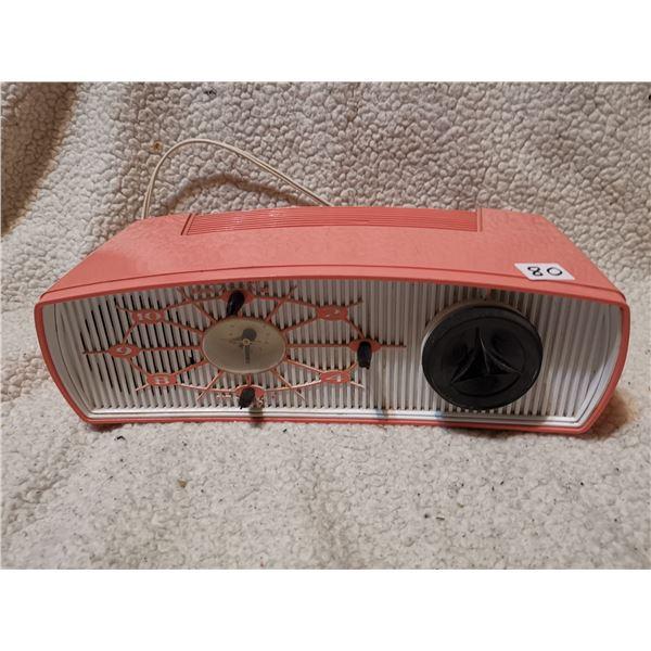 Vintage working radio clock, peach/pink color