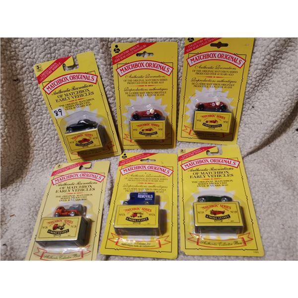Six matchbox sealed cars