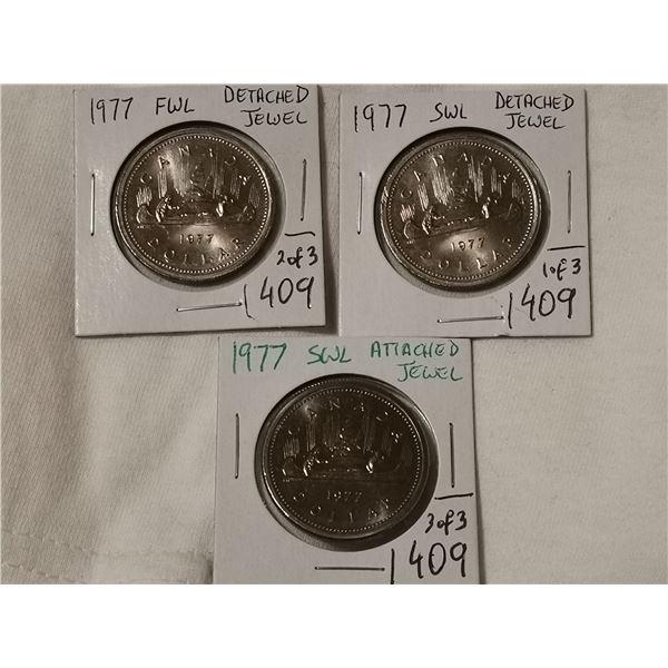 3 different 1977 dollar coins