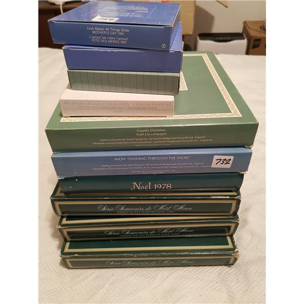 10 collector Avon xmas plates
