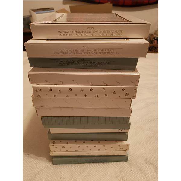 14 collector Avon xmas plates