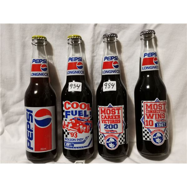 4 Full collectible Pepsi bottles