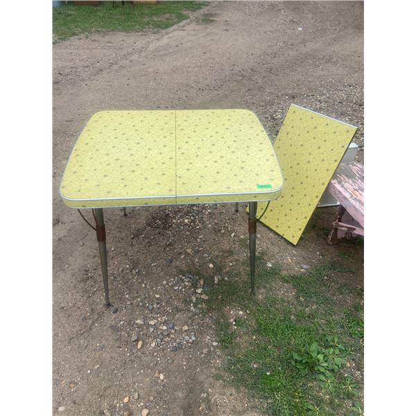 """1950's yellow kitchen table, comes with leaf 36"""" X 30"""" & 54 X 30 with leaf in"""