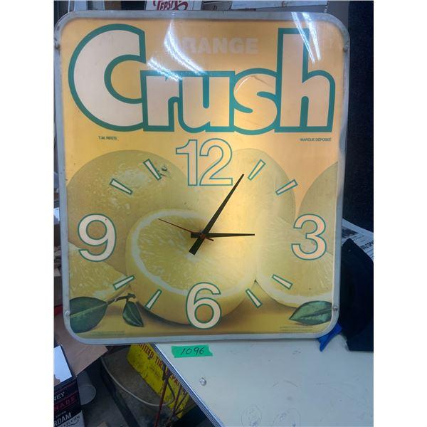 "Orange Crush clock, working. Has some cracks on plastic 23"" X 26"""