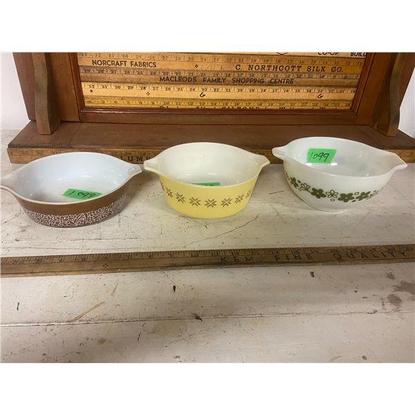 "3 Pyrex bowls 6"" across"