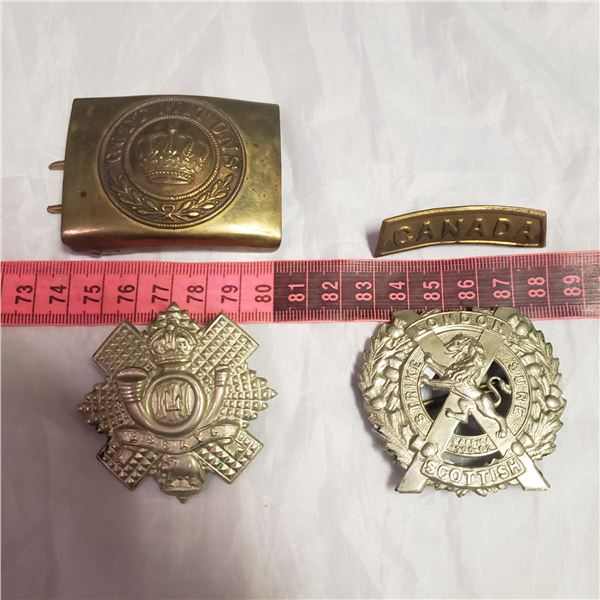 four Militaria military / RCMP / her Majasty  style badges medals