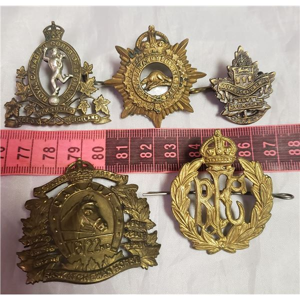 five Militaria military / RCMP / her Majasty  style badges medals
