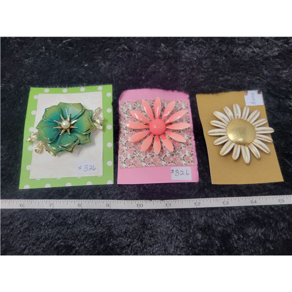 Floral broaches (3)