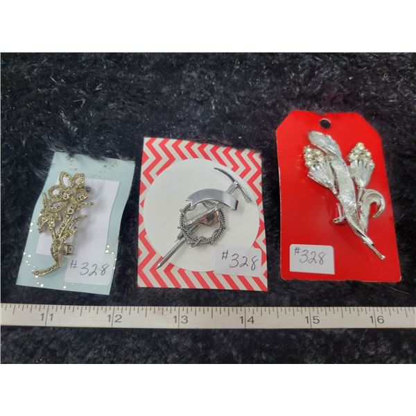 Lot of silver tone broaches (3)