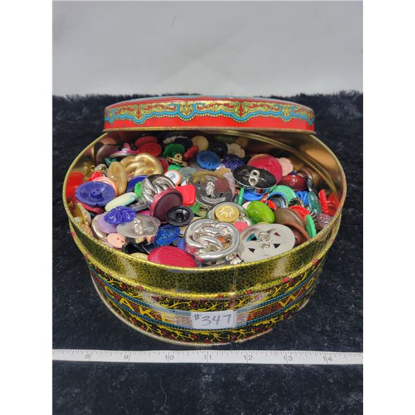 Large decorative cake tin of vintage buttons
