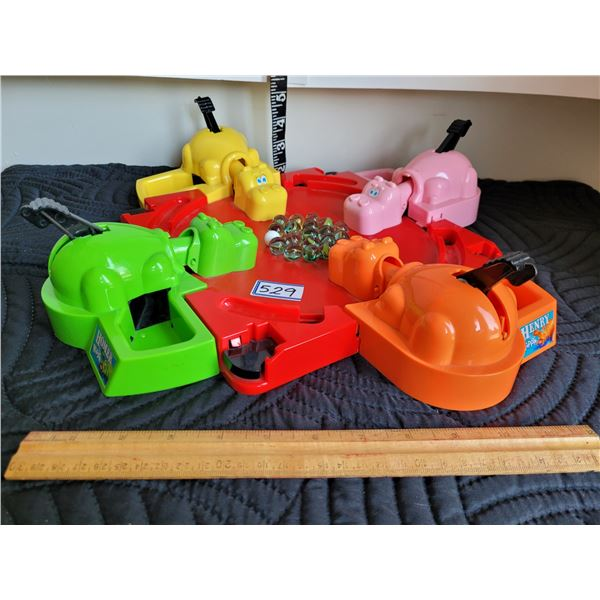 Older Hungry Hippos marble game.