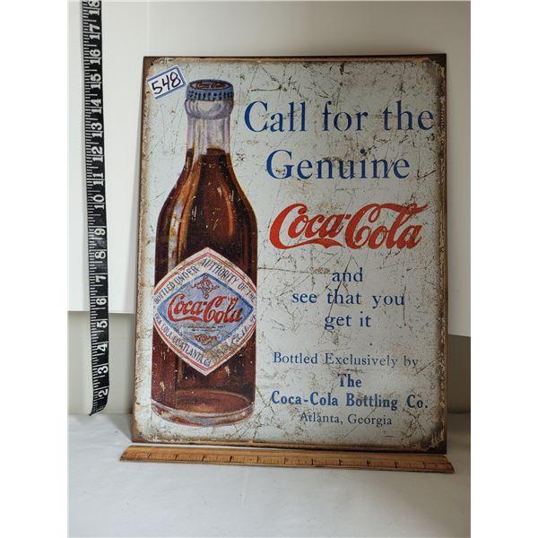 Coca-Cola reproduction tin sign.