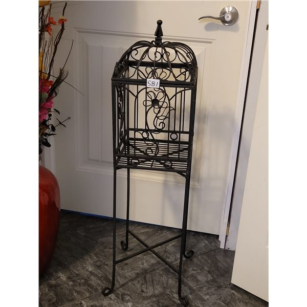 Ornate metal plant stand with removable top and legs.