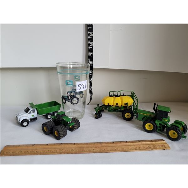John Deere Die-cast toys and large drink glass.