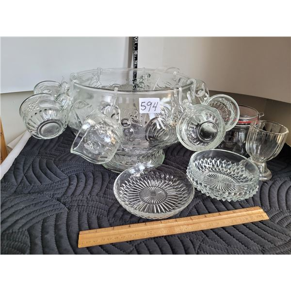 Clear glass punch bowl with 8 cups. Various other glassware.