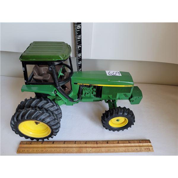 Ertyl, metal John Deere tractor.