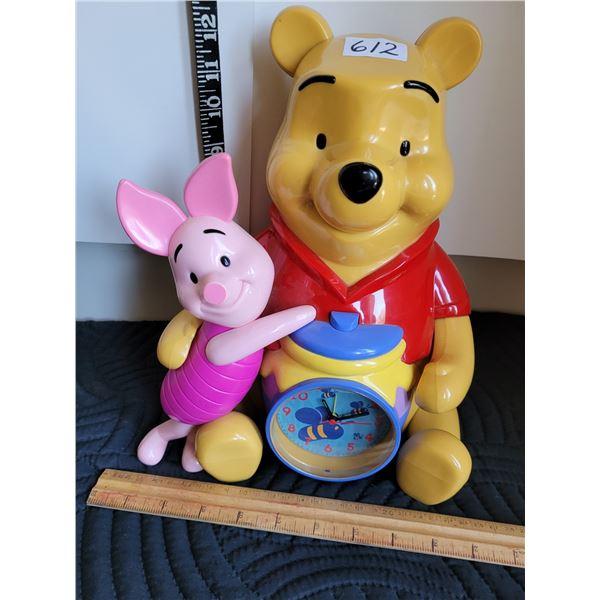 Winnie the Pooh & Piglet alarm clock, piggy bank. Plays theme song.