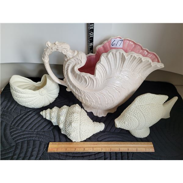 Unique shell pitcher with serpent handle. Ceramic fish & shell decor.