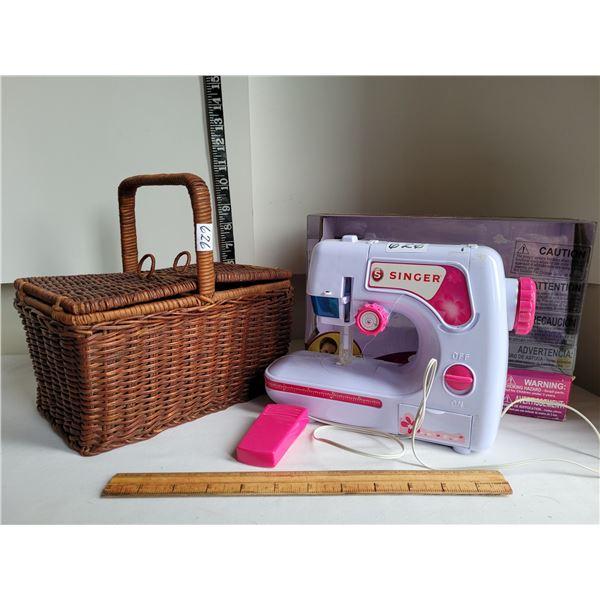Beginner Singer sewing machine & wicker storage basket.