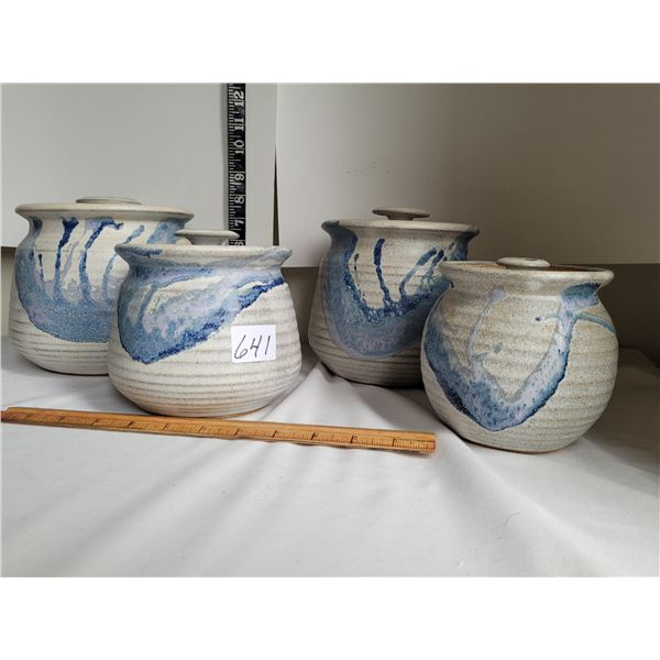 4 piece hand made pottery cannister set. Glazed and fired.