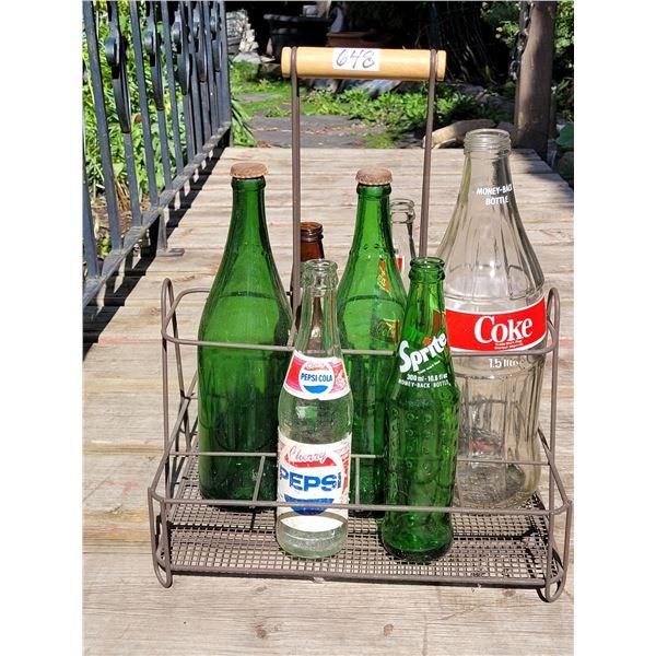 Old milk bottle carrier with vintage pop bottles.