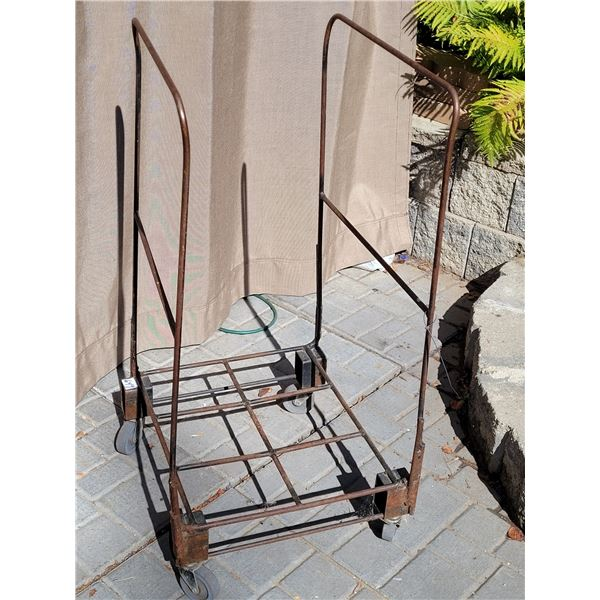 Metal, wheeled trolley hauler.