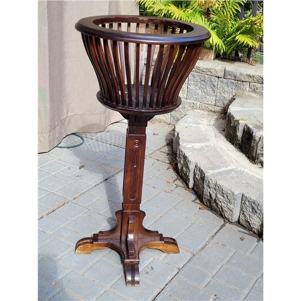 Vintage wood fern plant stand.