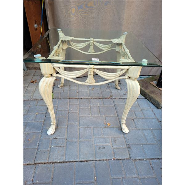 Vintage cast iron parlor table with beveled glass removable top.