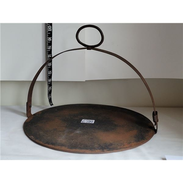 Antique heavy metal hanging fireplace kettle support.