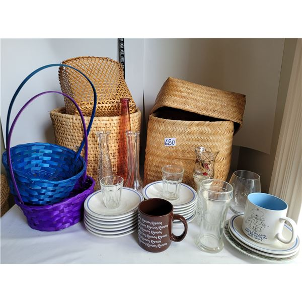 Wicker baskets filled with vases, candle holders and dishes