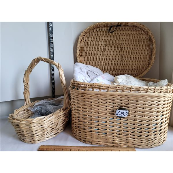 Wicker baskets filled with vintage linens & curtain hooks.