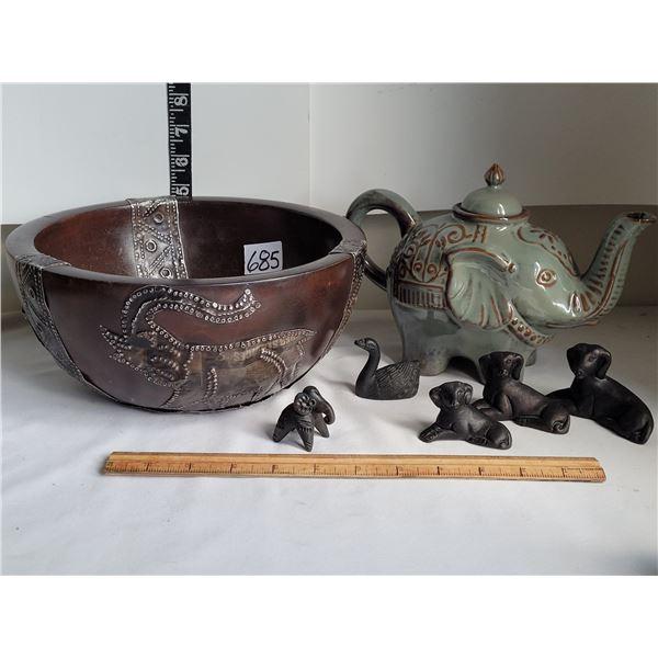 Ornate bowl from India, Elephant teapot (cracks), animal carvings.
