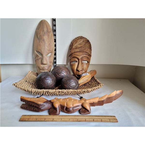 Rope dish with wood tribal masks, wood parrot, alligator & ornamental wooden balls.