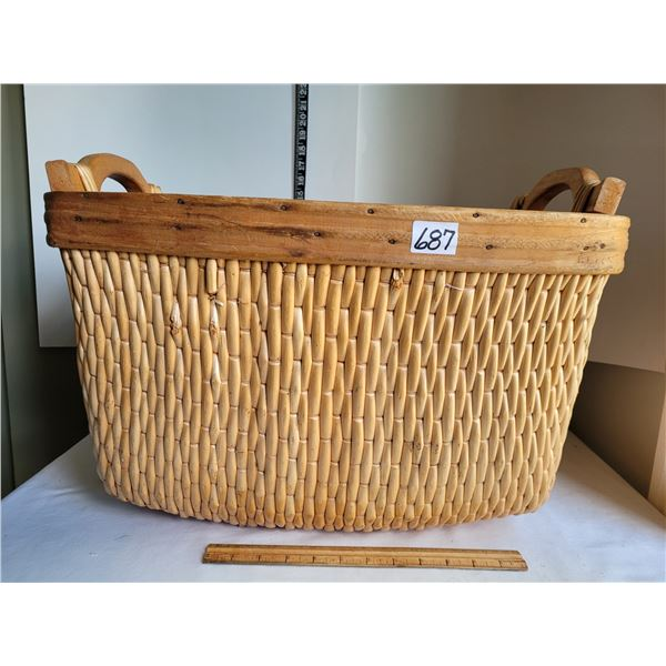 Large well made wicker and wood laundry basket.