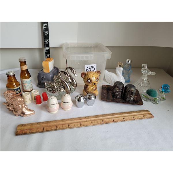 Tub of vintage collectables: salt & pepper, bell, perfume bottles.