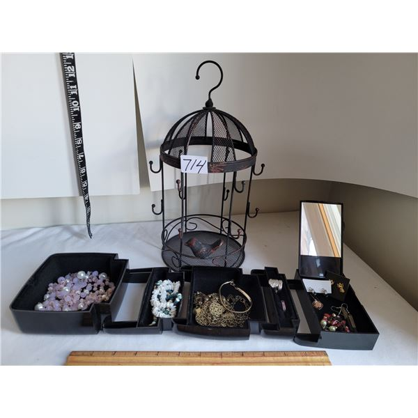 Fold out travel jewelry holder with costume jewelry + cage chain holder.