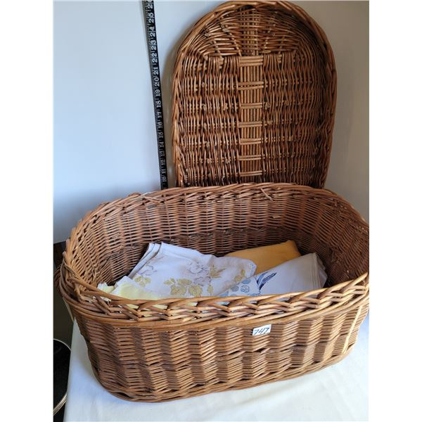 Large wicker basket with lid, plus vintage table cloths.
