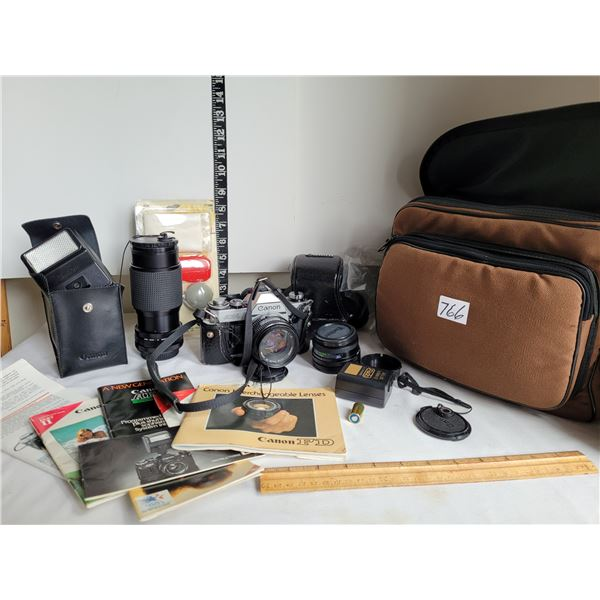 Canon AE-1  50mm 1:18- Extra wide angle lens 1:28.  Zoom lens 80-200mm 1:45.  Flash, cleaning kit, b