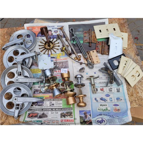 Lot of hardware: hinge, turn buckle, doorknobs, switch plates, clothes line reels, Etc.