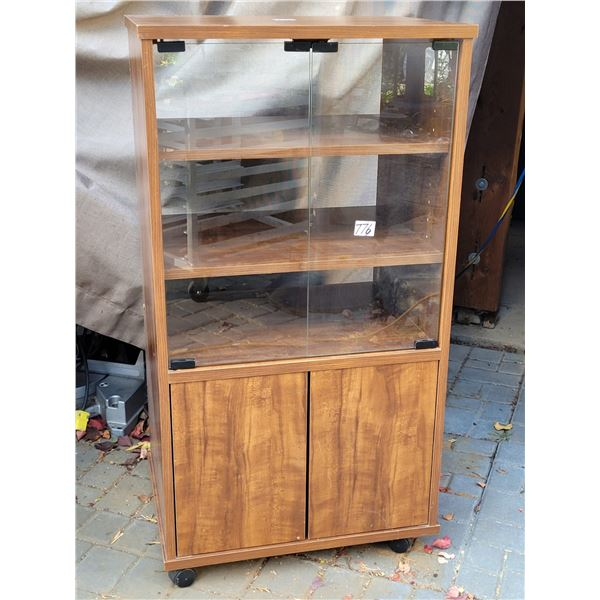 """1970's stereo component cabinet    on castors. Spring close doors, record rack. 39""""H X 20 3/4""""W  X 1"""