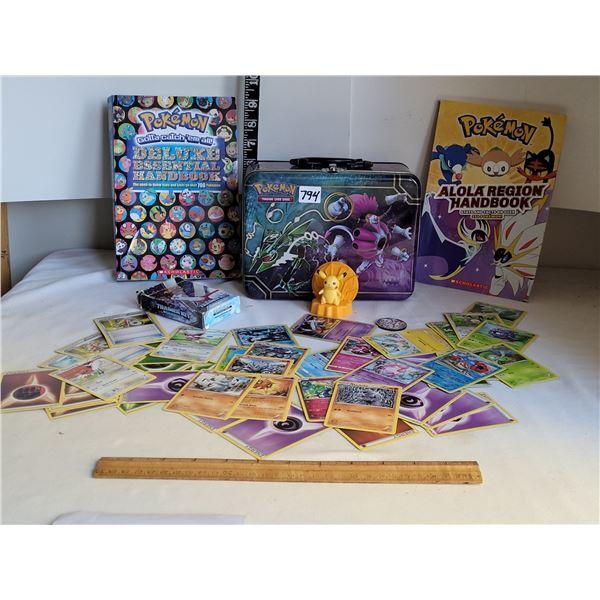 Pokemon. Collector tin, trainer kit cards, figurine & handbooks.