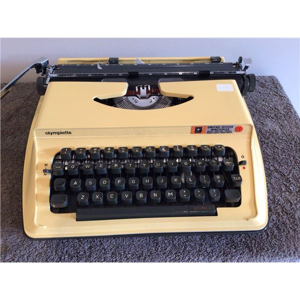 Vintage Olympiette portable typewriter - yellow, with case.  Very nice