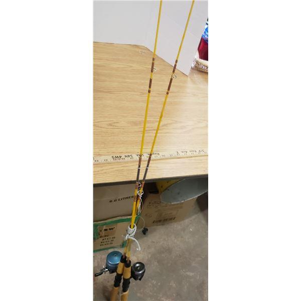 Pair vintage fishing rods and reels