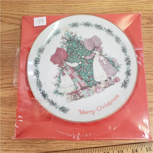 Holly hobbie Christmas plate 1980 unopenned Hobby (tear in plastic seal)