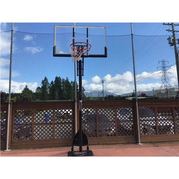 BASKETBALL NET (BOLTED TO GROUND MUST BE REMOVED)