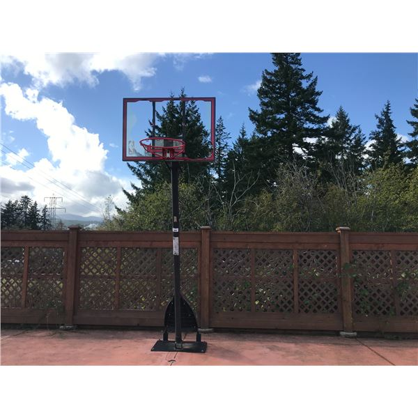 BASKETBALL NET (BOLTED TO GROUND MUST BE REMOVED) BROKEN PLEXI-GLASS