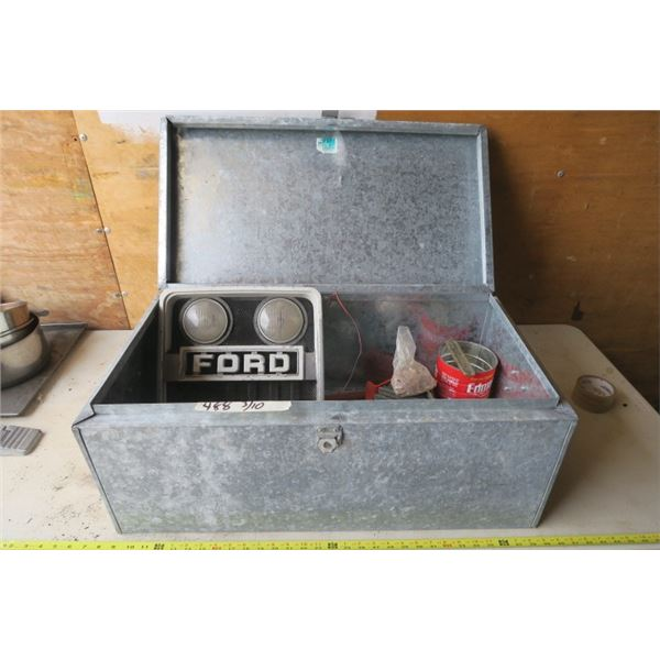 Metal Foot Locker w/ Contents Including A Vice and Ford Tractor Grill