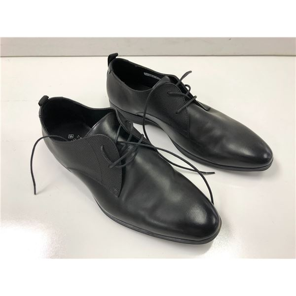 Pair of Call It Spring Vegan size 10 black dress shoes (from movie set)